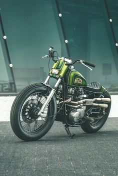 Deep green metalflake, a bobbed rear end and fat vintage rubber: we haven't had that spirit here since 1969. Click through for more shots of Nozem's fabulous old school Yamaha XS650.