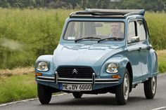 Citroen Dyane - put curtains and a bed in it and took it to France, of course.