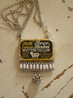 Jewelry, handbags, and funky vintage clothing redo by Melody Elizabeth. This is her tin pill boxes and rhinestone necklace