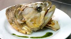 Okay so I wasn't looking for a disgusting food when I came across this dorado head. This is how they eat them in Spain. I was looking for a recipe for tilapia. What the absolute fuck. Does it look rotted?? It should! that's part of its charm. Now excuse me while I go barf up all the Oreos I just ate.