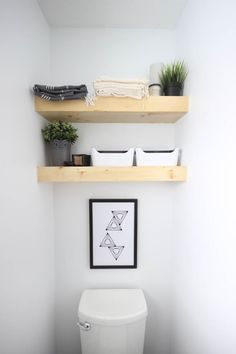 Learn how to build your own floating selves between two walls! This DIY takes no time at all and looks amazing! Love the modern feel of these shelving units.