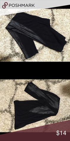 Black Leggings with Leather Detail Black leggings with leather (faux) detailing cut out on both sides. Lots of stretch - 95% Polyester/5% Spandex. Epique Mua Pants Leggings