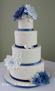 Gorgeous white wedding cake with blue accents