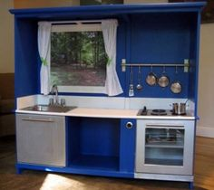 Old ghetto entertainment center turned into a play kitchen.  The stove and dishwasher are stainless steal paint.  Make the curtains. by helene