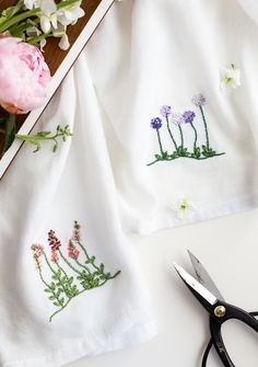 Tiny embroidered blooms on a plain white tea towel makes for a fabulous summer craft project. Use your garden for inspiration or print this color template to create the same set shown here. You