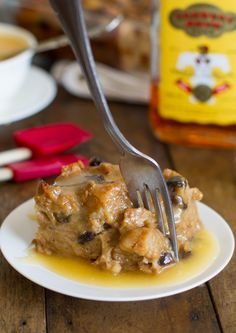 Bread Pudding with Hot Butter Rum Sauce  •7-8 cups torn or cubed French bread  •¾ cup dark brown sugar  •3 cups milk  •4 tablespoons butter  •1 teaspoon cinnamon  •1 teaspoon vanilla  •⅔ cup raisins  •¼ cup rum, divided  •4 beaten eggs  •⅓ cup heavy cream  •1 cup sugar  •½ cup butter