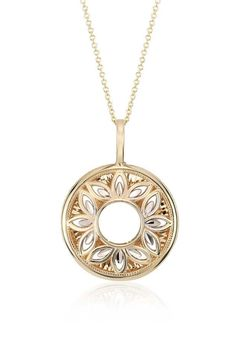 Beautiful as it is chic, this pendant, forged of both 14k yellow and white gold, features a delicate design of open filigree work in a floral pattern.