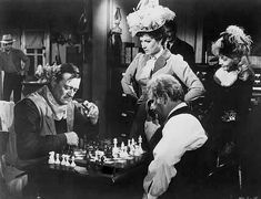 John Wayne playing chess