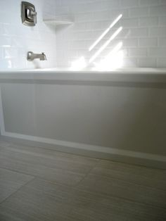 Kohler Archer Tub with Florim Stratos Avorio 12x24 Porcelain Tile.. love the light tile for the bath....