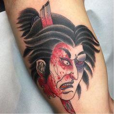 Risultati immagini per testa mozzata tattoo