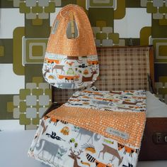 This gorgeous, soft and luxurious gift set comprises of a bib and burp cloth made using two organic cotton prints, a quirky animal print featuring forest animals such as owls, foxes and deer and a matching scribble fabric in orange.Both organic fabrics are from Ed Emberley's fabric collection where the inspiration came from his Drawing Book of Animals, which was his first learn-to-draw book originally published in 1970 and still going strong today.This set makes a very special present…