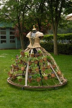 A mobile, wearable garden built into a dress hoop! By artist Nicole Dextras. I find this interesting. I'd love to make this for my yard, but I see it covered with vines or a flowering vine!