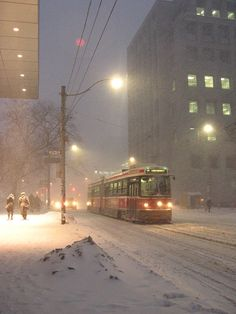 Snowstorm with streetcar, winter in Toronto.