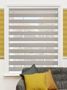 Create a shady space without blocking all of the light with the Enjoy Dimout blind in Silver for a urban chic design.