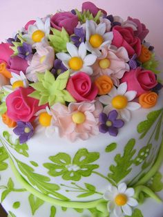 Flower cake - I like the cluster of different fondant flowers