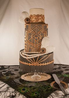 Great Gatsby wedding cake // While I love the design work on all of the Gatsby stuff.... Your wedding theme being a book about decadence where none of the married persons are happy is a HORRIBLE idea.