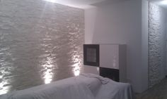 living room with white  stone wall  in munich
