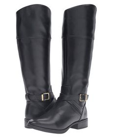 About as classic as they come, these black riding boots have those just-right equestrian touches (note the buckle and arched tops) that mean they'll never go out of style. Also available in brown suede.