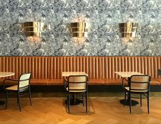 A Girls Weekend in South Beach, Miami: Gorgeous midcentury modern decor with brass sconces, black and white leaf print wallpaper, herringbone floors, and cane back chairs in the Driftwood Room at the Nautilus Hotel | Scotch and Nonsense