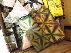 Tsuyoshi Kuno's clamp resist (itajime) napkins and triangle clamps. Photo by Barbara Shapiro 2014