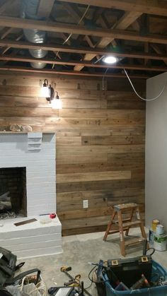 Pallet wood wall made using cedar fence pickets from lowes. Bonus is consistent width, no disassembly of pallets!