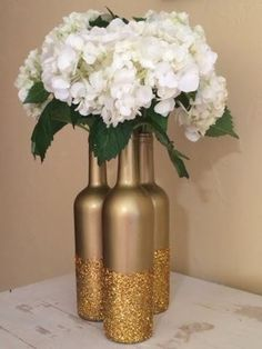 20 Creative DIY Wine Bottle Wedding Centerpieces for Your Big Day – Page 2 of 2 glitter and metallic gold dipped wine bottle diy wedding centerpieces – Glitter Wine Bottles, Wedding Wine Bottles, Wine Bottle Crafts, Wine Bottle Centerpieces, Wedding Table Centerpieces, Wedding Decorations, Centerpiece Ideas, Centerpiece Flowers, Table Decorations