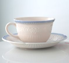 MY FAVORITE DISHES EVER!  I got a set of 6 for my high school graduation present.  Love these. Anchor Hocking Vitrock Alice Cup and Saucer