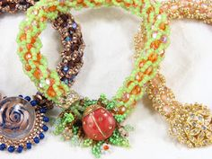 Free Bead Crochet Patterns including leopard bead crochet patterns, 4 favorite bead crochet products, beaded crochet ropes, bead crochet classes and how many beads do I need for bead crochet, as well as videos on making crochet beads, how to crochet with beads and beginning bead crochet.