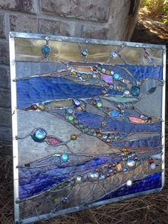 Stained glass abstract window with different clear textured glass, cobalt mystic , blue color stained glass and mixed nuggets. Patina is black, measures 19 x 19 Framed in zinc. Brass hangers on 2 sides . so its ready to hang on the window. These pieces are sold but I would love to work on a similar design for your home. Please contact for a quote on the size you need. Stained Glass Quilt, Stained Glass Flowers, Faux Stained Glass, Stained Glass Panels, Stained Glass Projects, Stained Glass Patterns, Mosaic Art, Mosaic Glass, Transom Windows