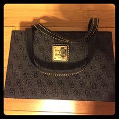 "Dooney & Bourke ""Tiny East/West"" Bag Dark denim, very gently used.  Inside bag is perfect, outside shows very little wear.  Cute summer purse! Dooney & Bourke Bags Mini Bags"