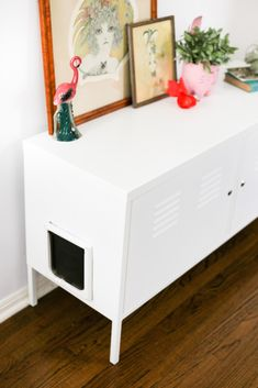 Kitty Litter Box Cabinet Hack Turn the Ikea PS Cabinet into a giant kitty litter box so you never have to look at litter again! // Salty Canary<br> I recently acquired a second cat, Lucy! The day I rescued her, I purchased a