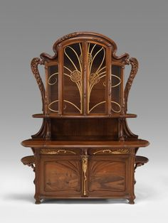 VMFA Art Deco & Art Nouveau Sideboard C. 1903 by Emile Gallé - French (1846 - 1904) Materials used: walnut, oak, chestnut, various fruitwoods, iron, gilding, glass.