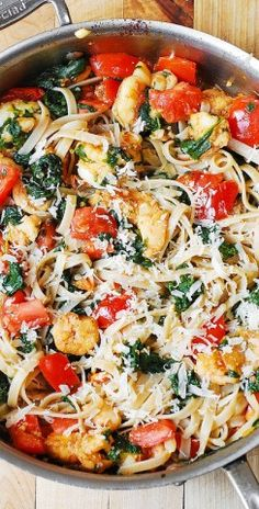 Shrimp, Tomato, And Spinach Pasta In Garlic Butter Sauce ~ Make this tasty Fettucine pasta for dinner and this recipe will be one of your most favourite ones for pasta.
