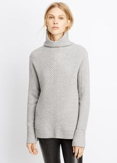 Wool Cashmere Directional Rib Turtleneck Sweater | Vince | $385 | A statement sweater for it's plush, directional knit and signature VINCE. fit, this turtleneck is made of a soft wool-cashmere blend. Easy through the body, it features extra long slim-fit sleeves that roll back at the cuff. The tall turtleneck comes with a curved front, and can be worn up or scrunched down. The split- seam high-low hem hits at the top of the thigh.