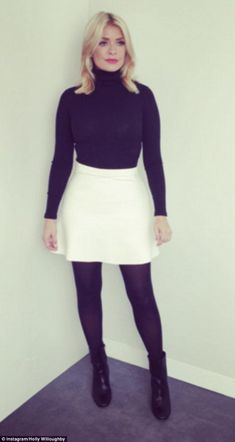 Holly's white skirt and black polo neck provoked a mixed reaction from Instagram followers...