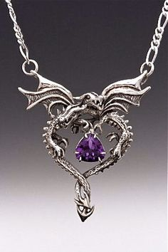 These two Dragons entwine gracefully to form the shape of a heart and clutch a sparkling natural 9mm trillion cut amethyst in their claws. Their wing span is 1 1/2 across. A 16 Figero chain is attached to both tips of the Dragons wings and is included in the price of the pendant making the overall length of the piece just shy of 18. Please note in the comment area of your order if you prefer a different length of chain. (This pendant is also available with a Blue Topaz, Citrine or Almad...