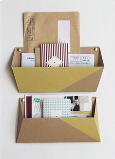 Cardboard Wall Pockets. Love this concept.