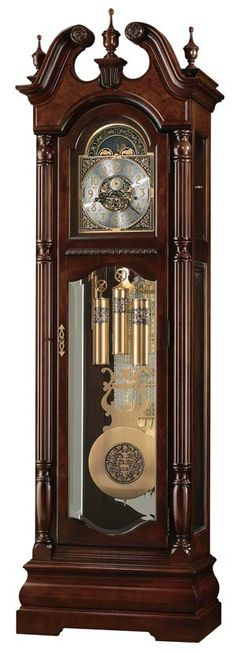 """Howard Miller Edinburg 611-142 is a special 82nd Anniversary Edition floor clock features a swan neck pediment with book-matched olive ash burl overlays and three turned urn finials, carved rosettes, and a decorative final support. Finished in Cherry Bordeaux on select hardwoods and veneers. Cable-driven, triple chime Kieninger movement offers automatic nighttime chime shut-off option.  Size: H. 90-3/4"""" W. 27-3/4"""" D. 17"""""""