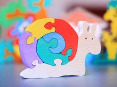 Wood Colorful Puzzle SNAIL. Handmade puzzle game that develops motor skills. Kids toy. Wooden ecofriendly handmade toys for children.. $10.00, via Etsy.