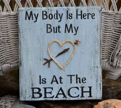 My Body Is Here But My Heart Is At The Beach, Handpainted Beach Decor Sign, Reclaimed Beach Wood. $24.00, via Etsy.