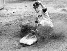 Mickey Mantle slides into base.