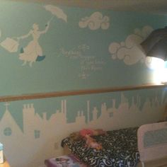 Mary Poppins kid's room. White silhouetted Mary, clouds and London with hints of color on Mary to define her coat and umbrella. Inspired by images from the Broadway show. Note: the umbrella hanging above the bed.
