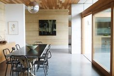 rammed earth, concrete and timber sliding doors