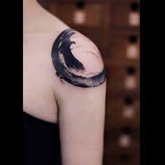 Black And Grey Zen Circle Tattoo On Left Shoulder