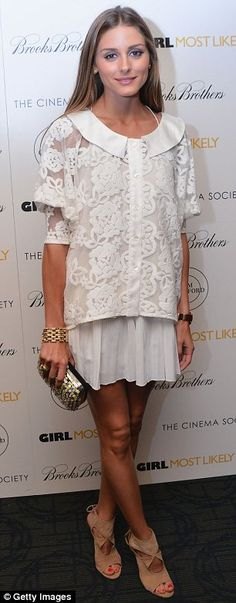 Olivia Palermo went monochromatic in an ivory lace blouse and stark white pleated skirt, save for a printed clutch and her beloved neutral Aquazurra cut-out booties. http://www.dailymail.co.uk/tvshowbiz/article-2364808/Olivia-Palermo-Johannas-Huebl-heartfelt-moment-romantic-stroll.html