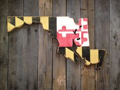 Here is a very unique Maryland painted onto the state of Maryland. The whole thing was hand cut from pine wood and hand painted. It was sanded