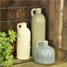 """TOP OF CHINA CABINET $21.99  Our Cold CellarJugs - Set of 3haveagraceful shapeas well as a crackled glazed finish inside and out, giving themthe look of unique vintage finds. Set includes soft grey, soft blue and white shades, so pretty together. As with any ceramics or stoneware, check the bottom for any rough area before placing on finished surfaces. 4"""", 7"""", and 10"""" H SHELF ABOVE WINDOWSEAT"""