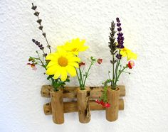 http://de.dawanda.com/product/69016691-Mini-Wandvase-Treibholz-Glas-Blumen-klein