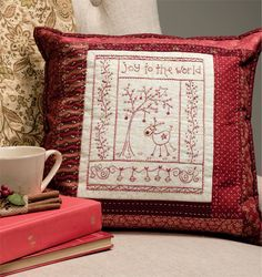 A redwork pillow with a tiny reindeer - such sweet embroidery! Designed by Gail Pan.