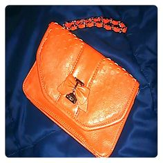 Lulu Guinness orange colored leather wristlet Poshmark does not have this amazing British designer on their plethora of designers list.  Deliciously amazing wristlet by renowned Brit designer Lulu Guinness. Lulu Guinness  Bags Clutches & Wristlets